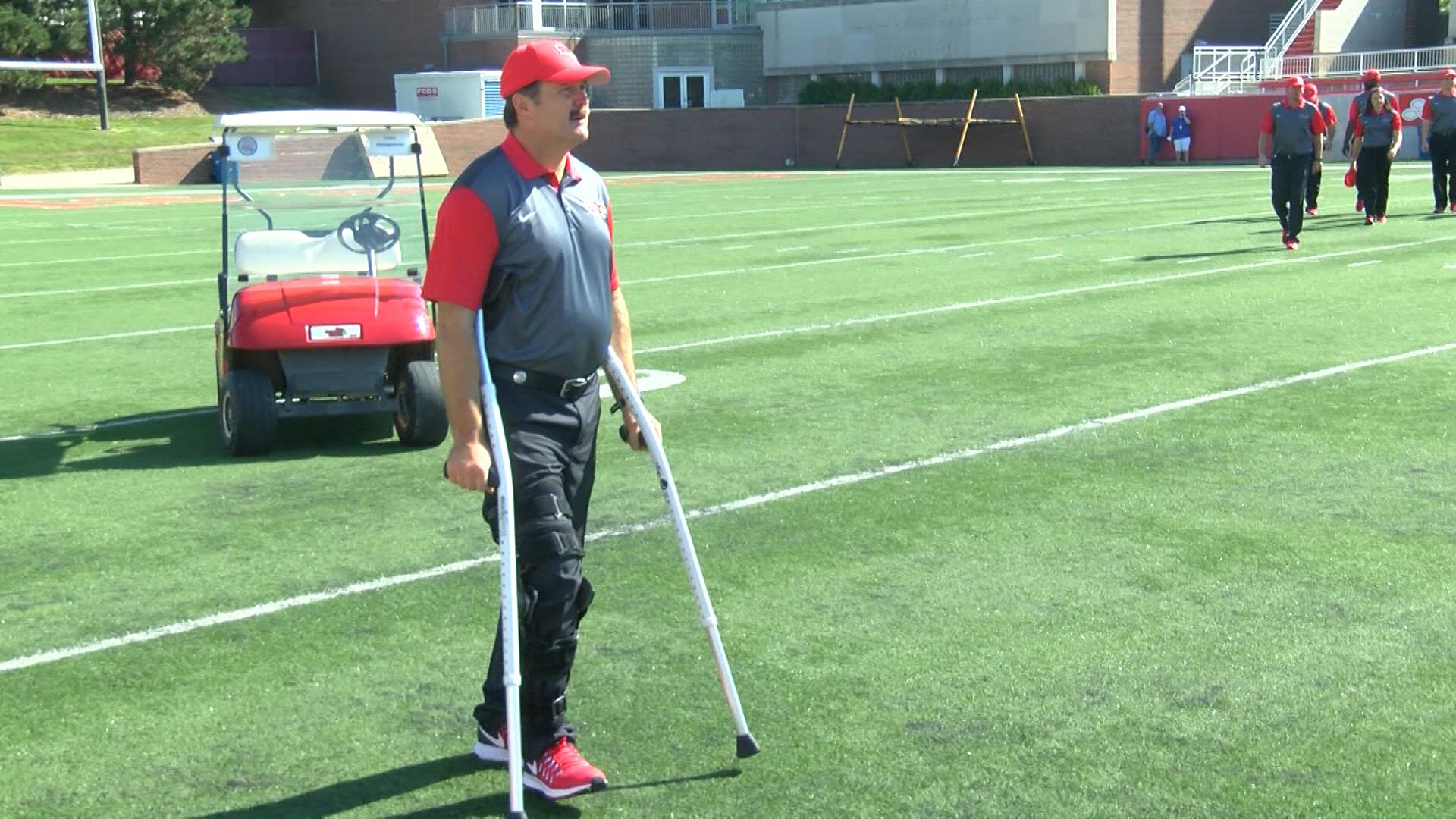Brock Spack on crutches_1472617073924.jpg
