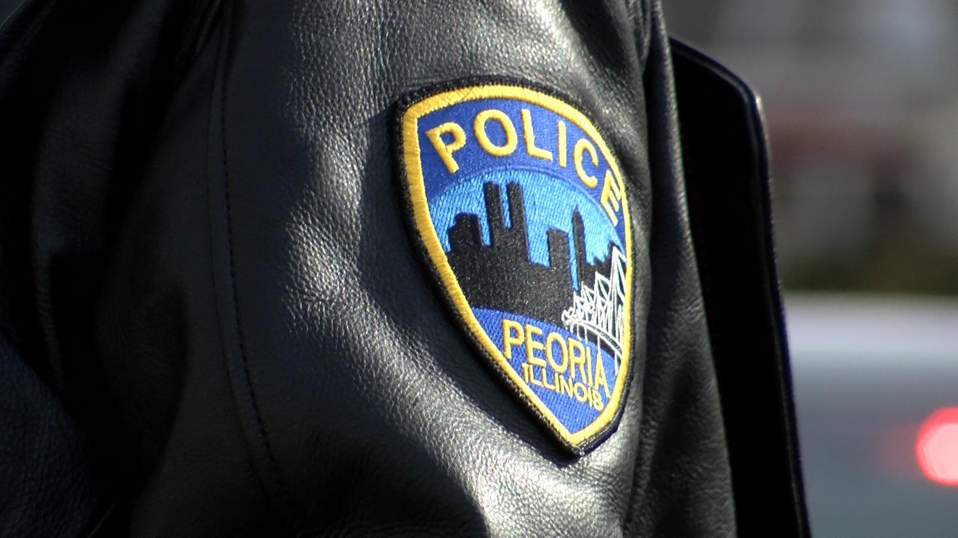 Peoria Police Badge_1550096014118.jpg.jpg