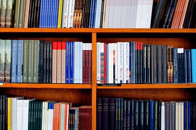 Educational textbooks on brown bookcase