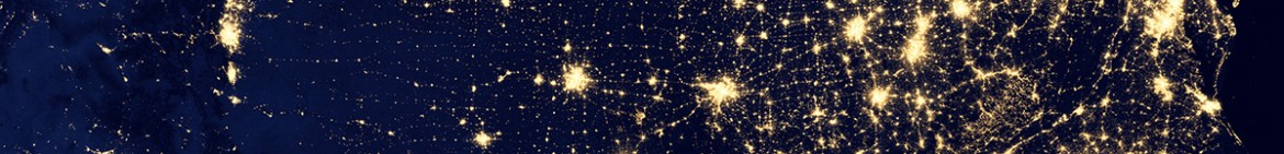 View of bright lights on earth from above at night