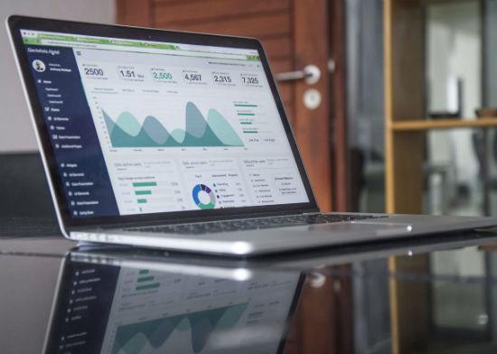 Laptop running analytics on table
