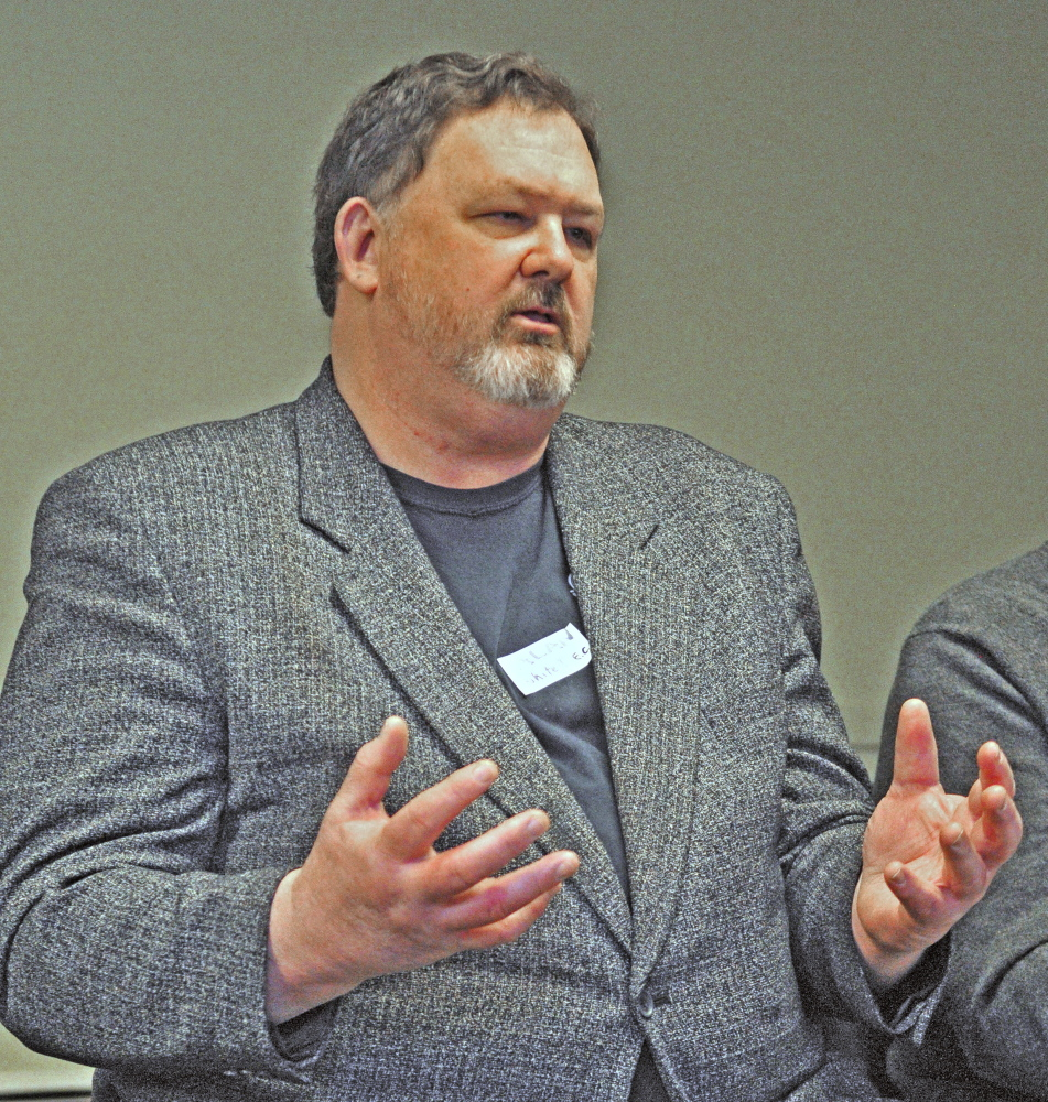 Alan White talks about the Island Employees Cooperative during a conference on business cooperatives Saturday at the Viles Arboretum in Augusta.