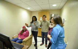 Students work with Professor KatieAnn Skogsberg on a research project concerning concussions and attention tasks.
