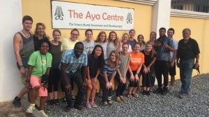 Students who took a three-week Centre Term class in Ghana pose for a photo outside The Aya Centre