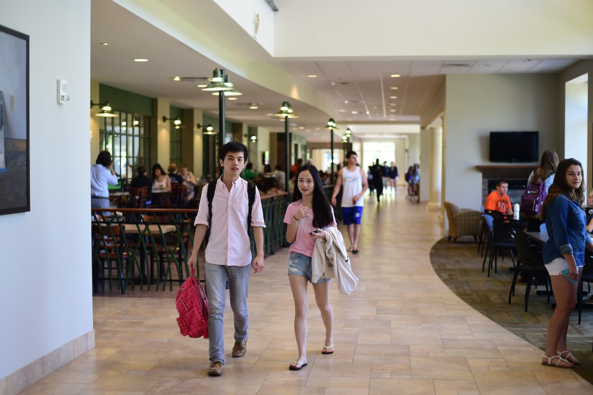 students walking inside the Campus Center
