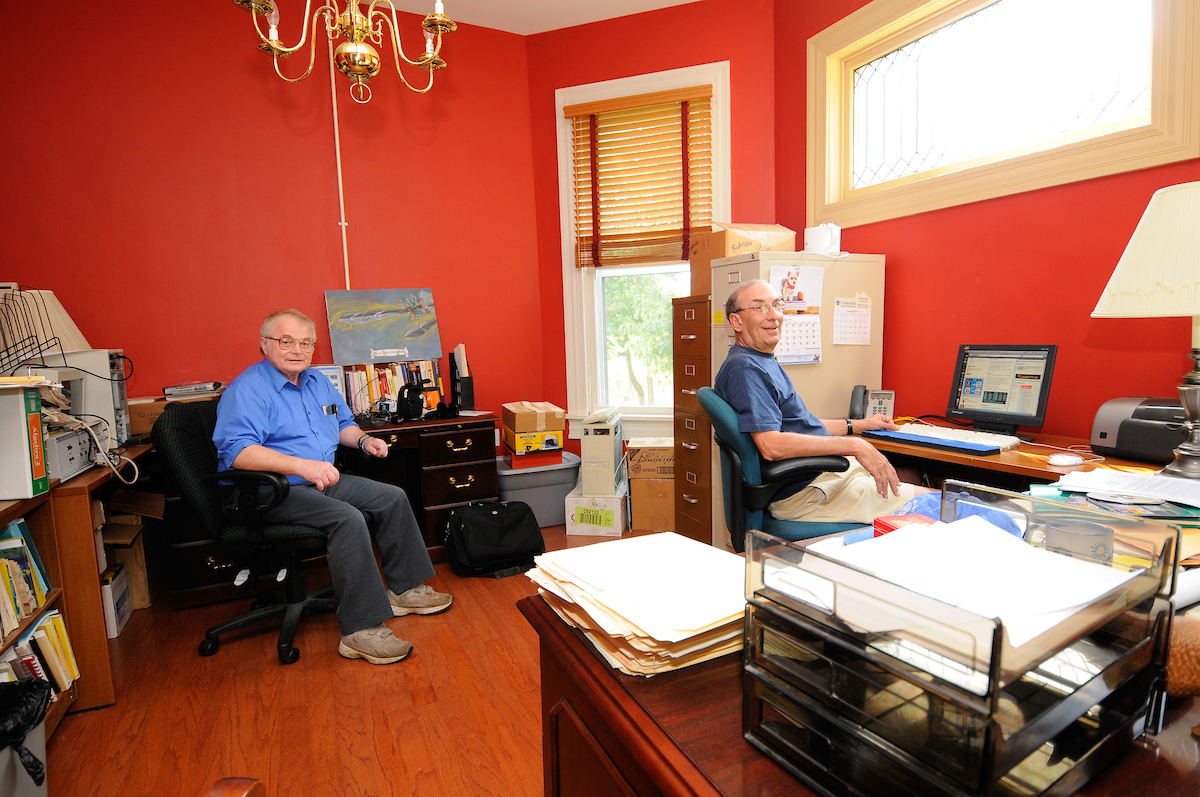 Emeritus Professors Don Brown and Brad Nystrom inside Cheek Emeritus House