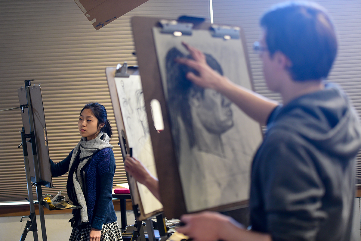 students in a live drawing class