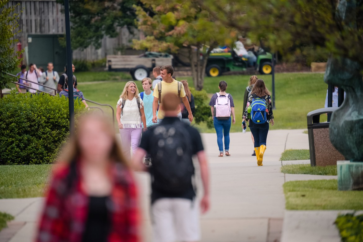 Students walk across campus during the first day of classes