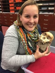 Rebecca (Williams) Cook '15 holds the cranium of an Australopithecus sediba juvenile male at the University of the Witwatersrand in Johannesburg.