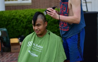 Photo of head shaving during St. Baldrick's event