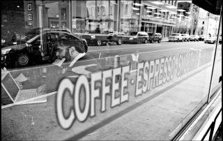 Photo of Professor Bo Weston in the downtown Hub Coffee Shop