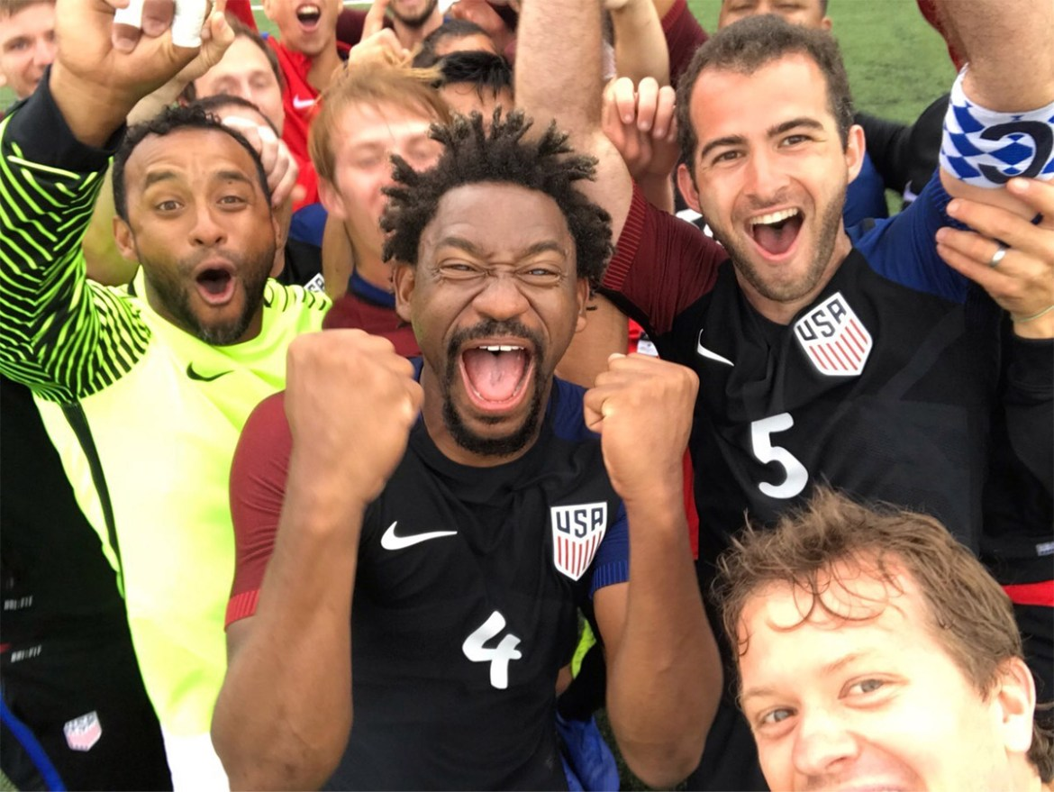 William Frentz '13 (No. 5) celebrates victory with USA Deaf Men's National Soccer Team