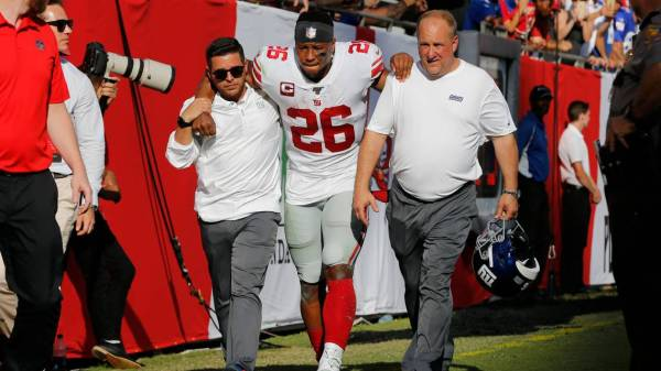 RB Saquon Barkley in walking boot, crutches after ankle injury Sunday