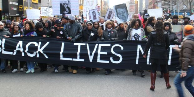 NEW YORK, NY - DECEMBER 13: Thousands of protestors converge on Manhattan's Washington Square Park to march through the Manhattan to protest the police violence on December 13, 2014 in New York, United States. Protestors shout slogans as Hands up, dont shoot, Black lives matter and I cant breathe during the march. (Photo by Mustafa Caglayan/Anadolu Agency/Getty Images)