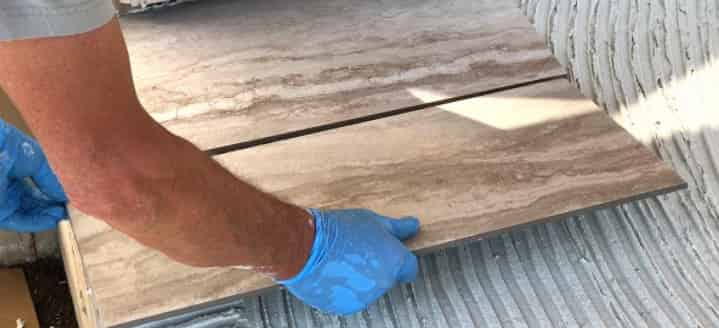 how to put tile on concrete slab