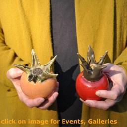 Anja holding two ceramic rosehips