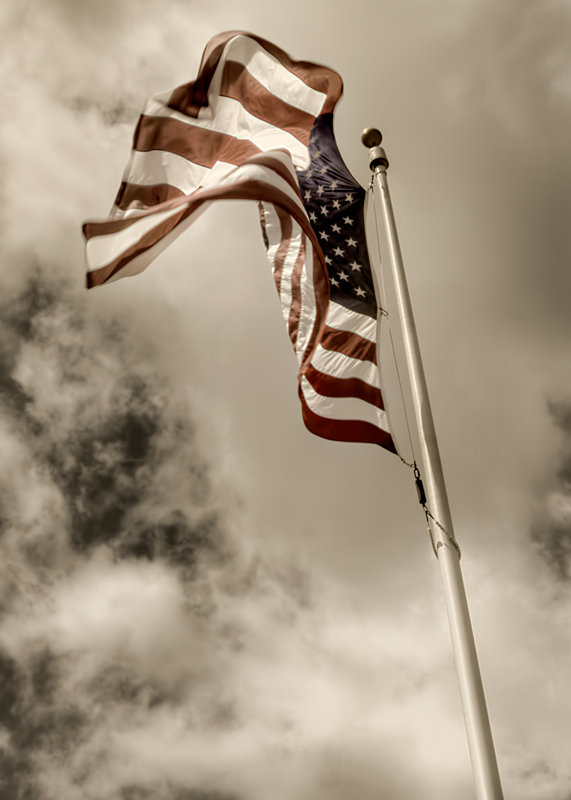 The flag of the United States waves in the wind