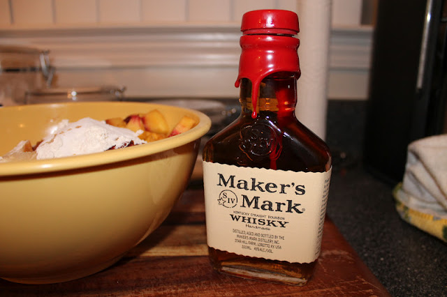Bottle Of Maker's Mark Bourbon Next To Bowl Of Ingredients