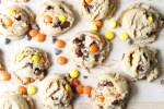 Reese's Pieces Peanut Butter Cookies on a platter with candies and chocolate chips