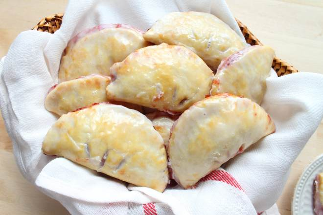Glazed Cherry Hand Pies - Super flaky pie crust stuffed with sweet cherry filling and finished with a sweet glaze
