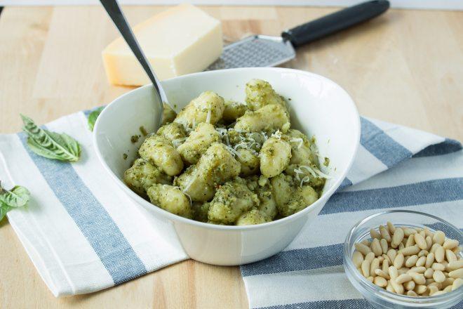 Homemade Gnocchi with Pesto Cream Sauce - Super fluffy homemade Italian potato dumplings (gnocchi) coated in a rich pesto cream sauce