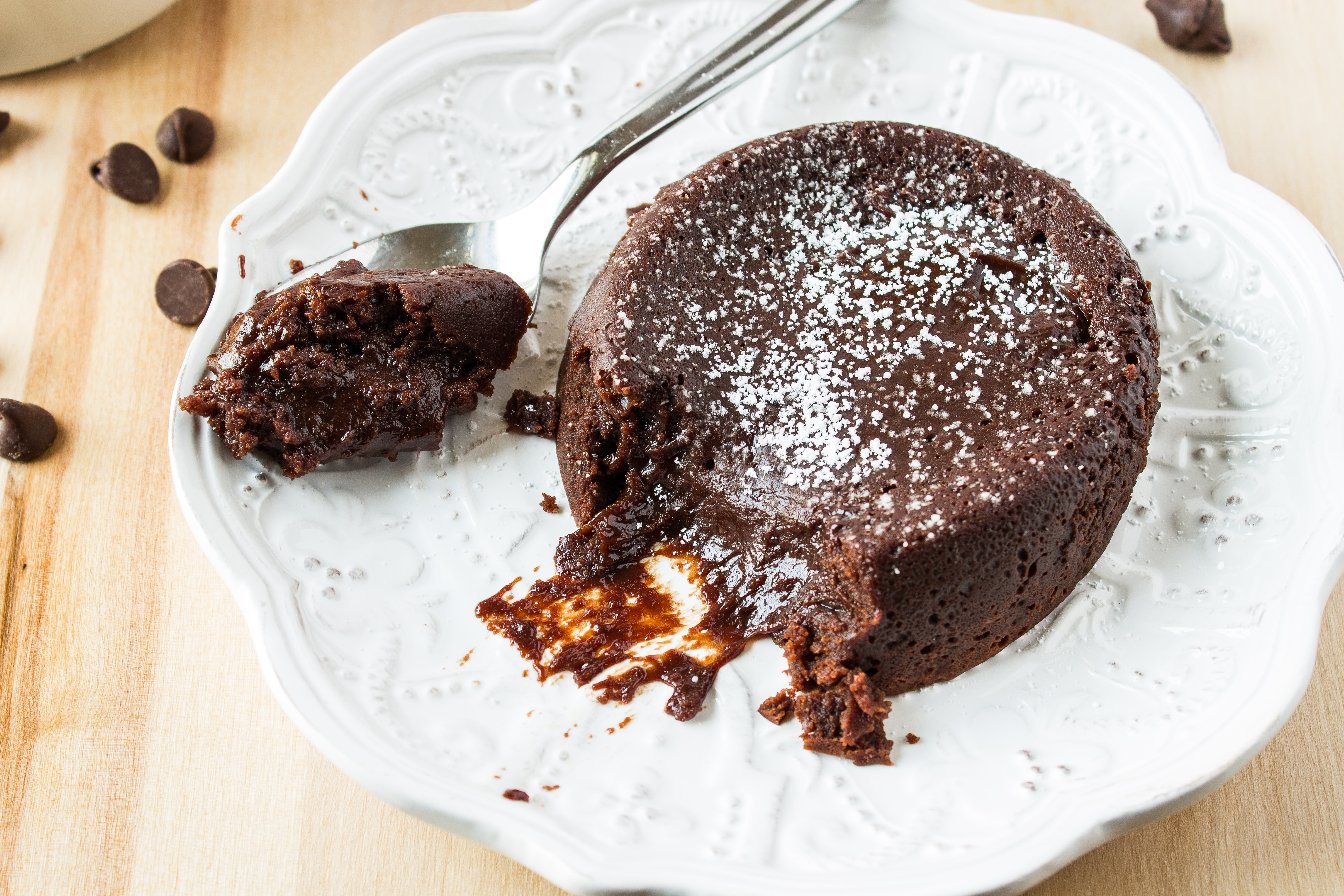 Molten Chocolate Cake - Dense chocolate cake that has a gooey molten lava center that will make your mouth water. It's a dessert that is sure to impress on your next date night or dinner party!