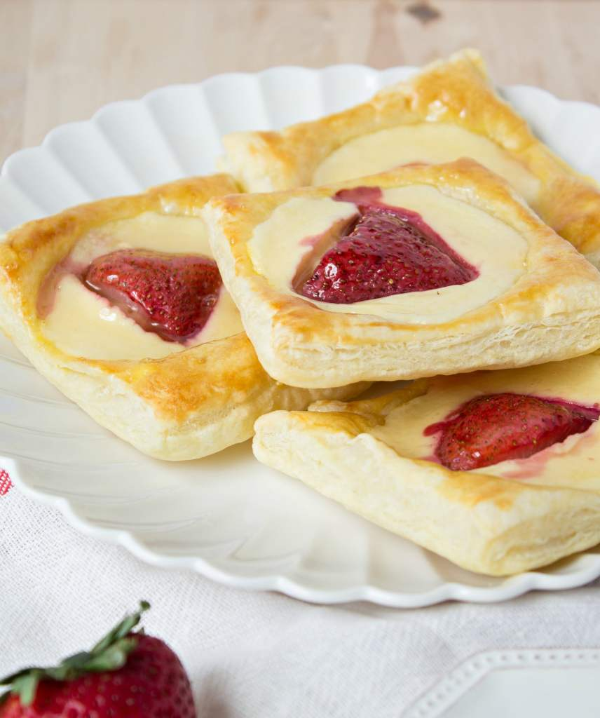 Strawberries & Cream Danish piled onto a plate