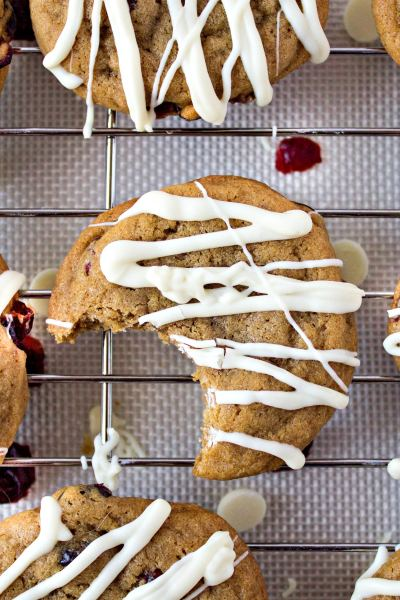 overhead zoomed in shot of cranberry cookies with white chocolate drizzle