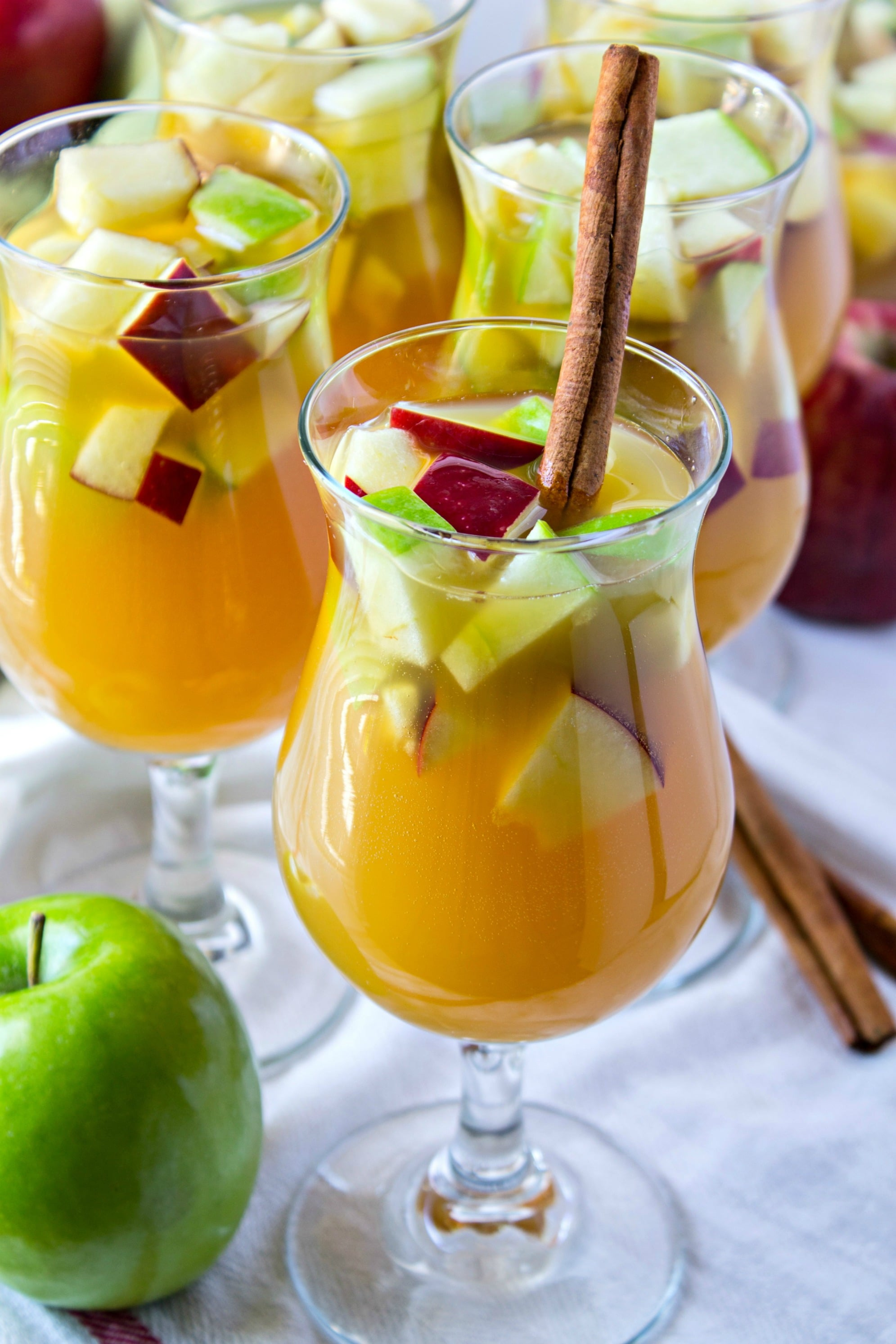 Sparkling Apple Cider Sangria - Apple cider, prosecco, amaretto, and ginger ale combine to make this delicious sangria. A perfect cocktail for the fall!