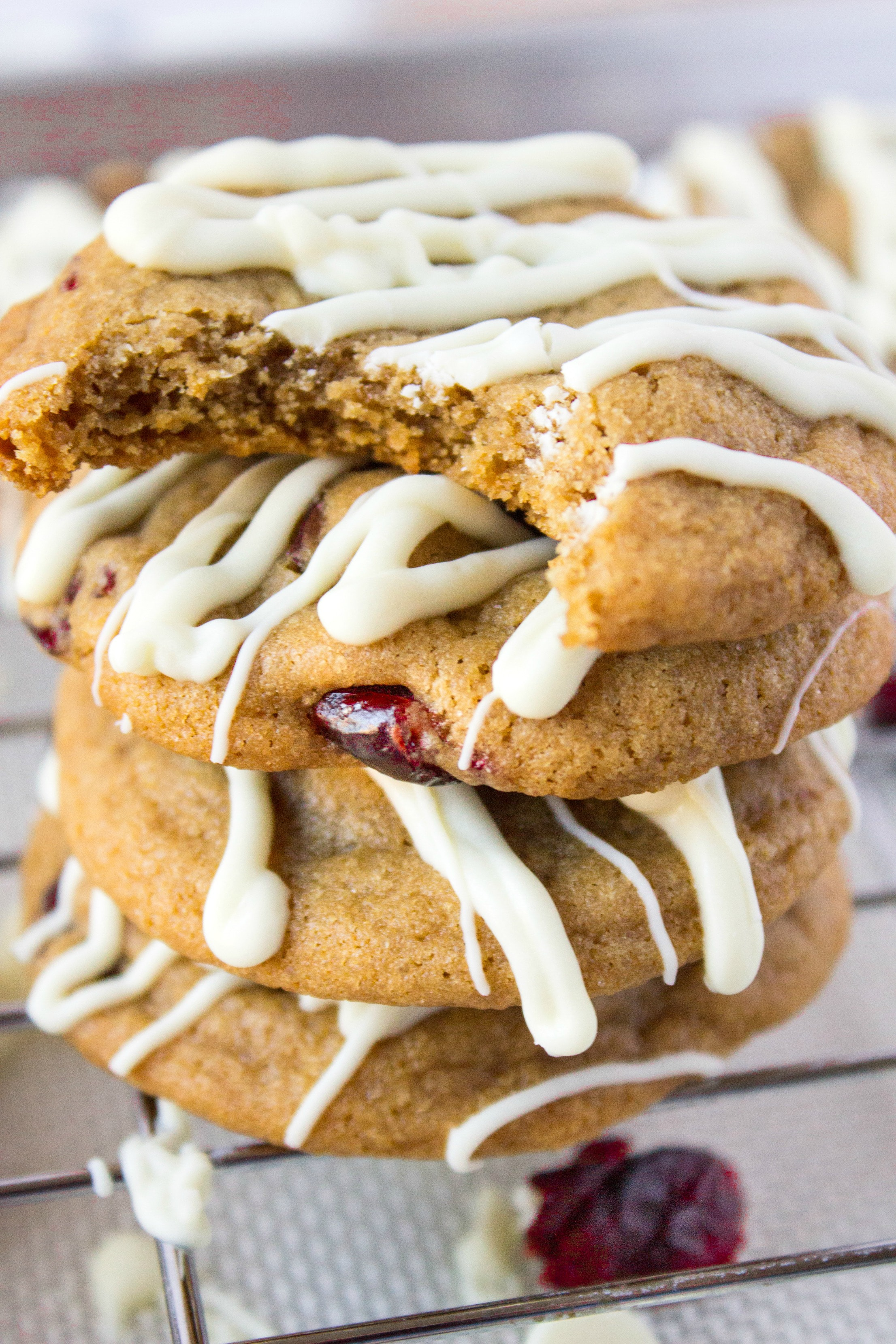 Stack Of Cranberry Cookies With White Chocolate Drizzle