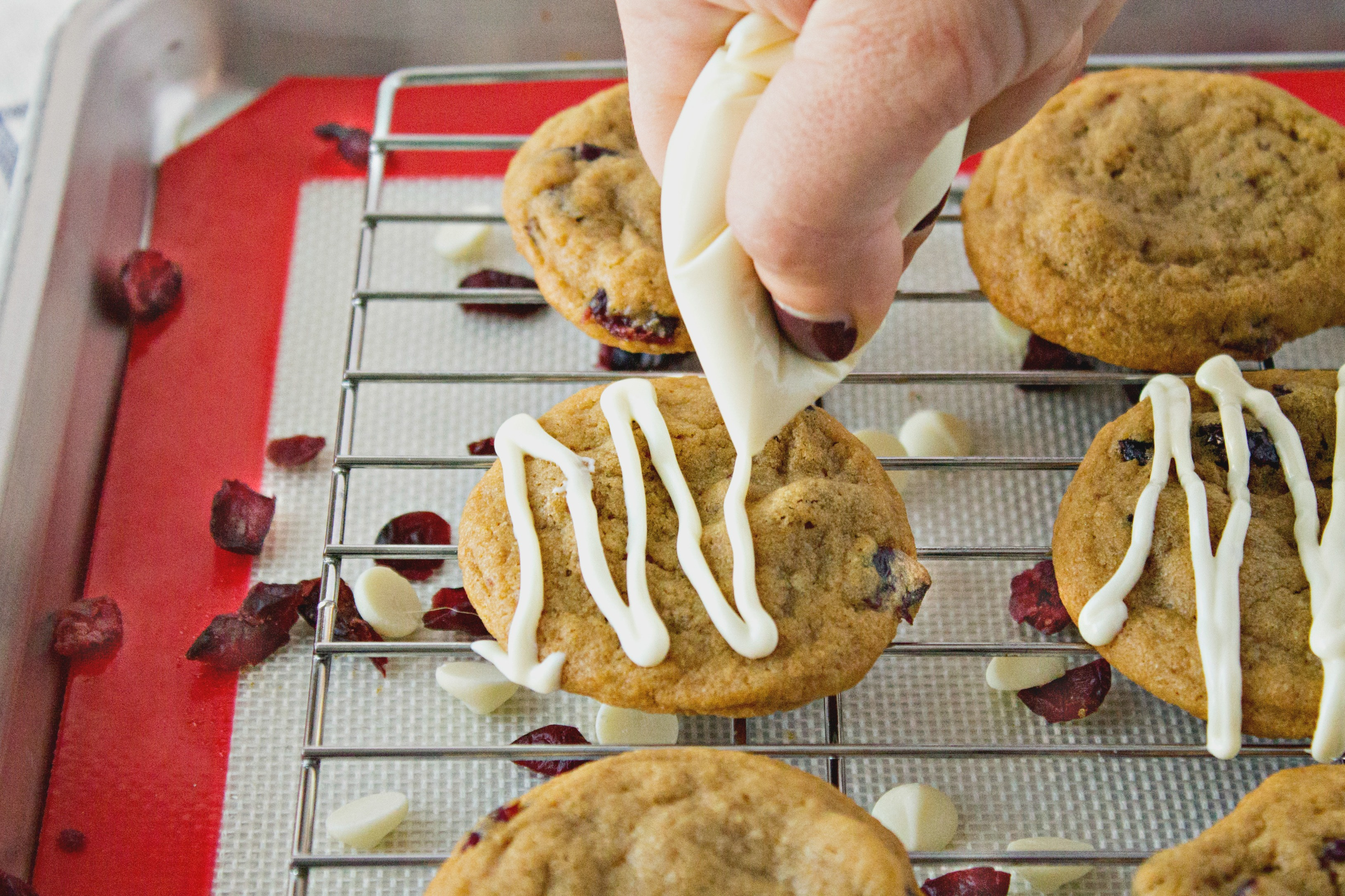 Drizzling White Chocolate On Cranberry Cookies
