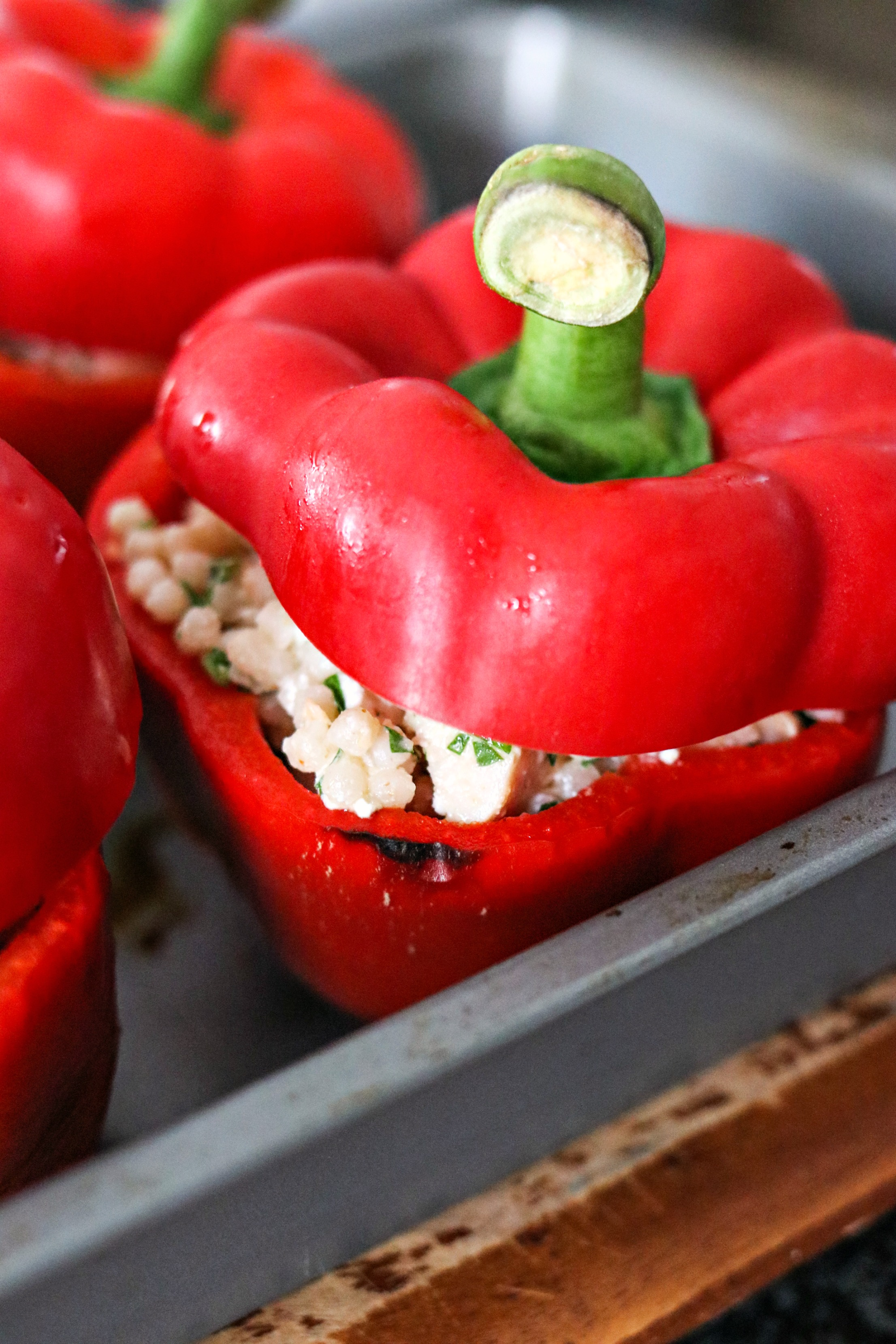 Chicken and Couscous Stuffed Peppers with the pepper top on
