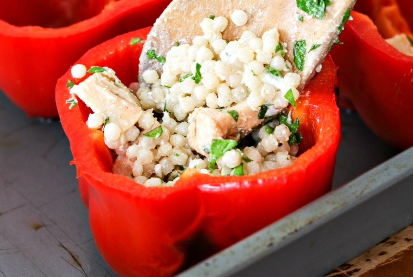 Chicken and Couscous Stuffed Peppers - A new take on stuffed peppers. This lighted-up option includes Israeli couscous, chopped chicken, parsley and goat cheese. The combinations of flavors is stunning. You won't be able to stop eating it!