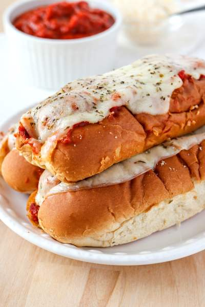 Easy Meatball Subs - Made with hot dog buns, frozen meatballs, marinara, and provolone, these meatball subs are so simple to make and perfect for feeding a crowd. Don't have a crowd to feed? You can easily adjust this recipe for a smaller group!