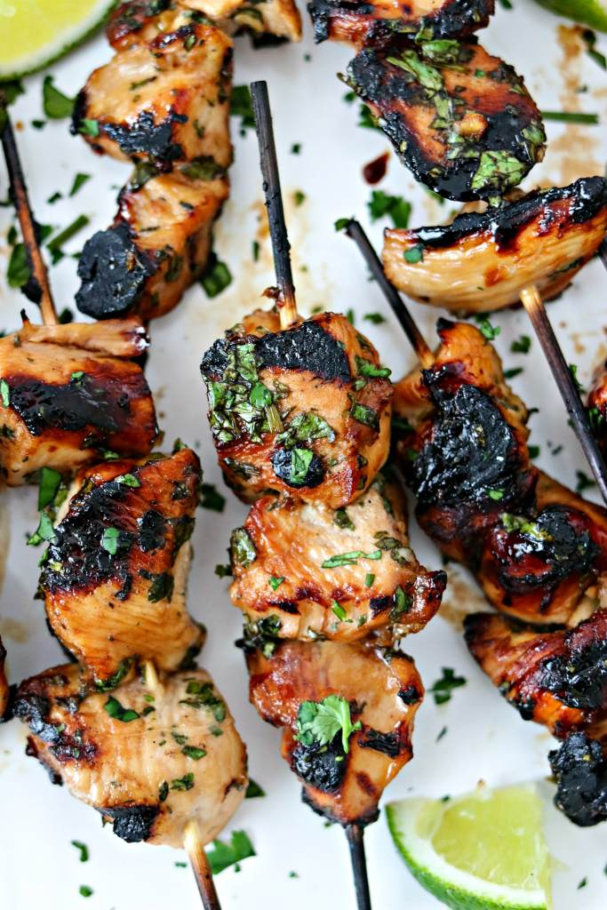 Grilled Cilantro Lime Chicken Skewers with lime wedges