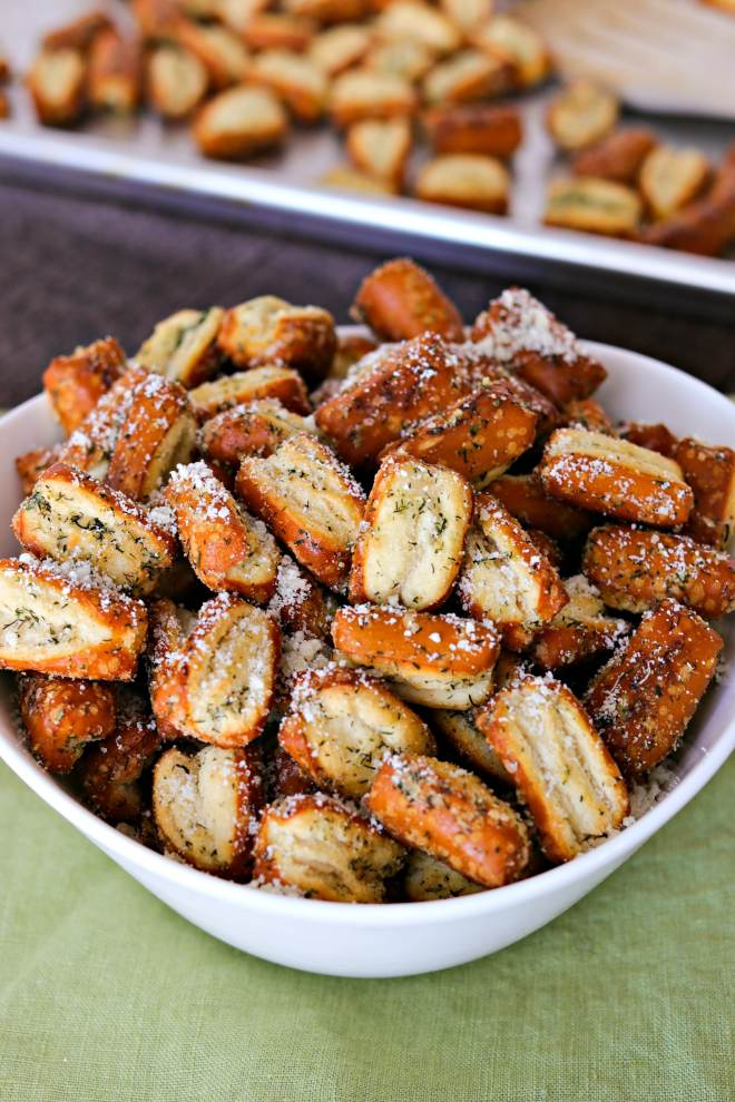 Easy Parmesan Garlic Pretzels - The recipe for these garlic parmesan pretzels couldn';t be any easier! You just toss store-bought pretzels in garlic powder, Parmesan cheese, dried dill, and a little oil and baked for 30 minutes! You'll have a fun, homemade snack in no time!
