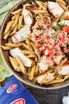 styled shot of Cajun Chicken Pasta with a box of Barilla penne