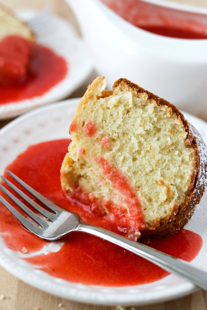 a slice of Cream Cheese Pound Cake with Strawberry Coulis on a plate