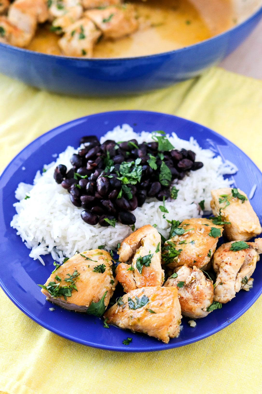 Cilantro Lime Chicken Bites next to rice and black beans