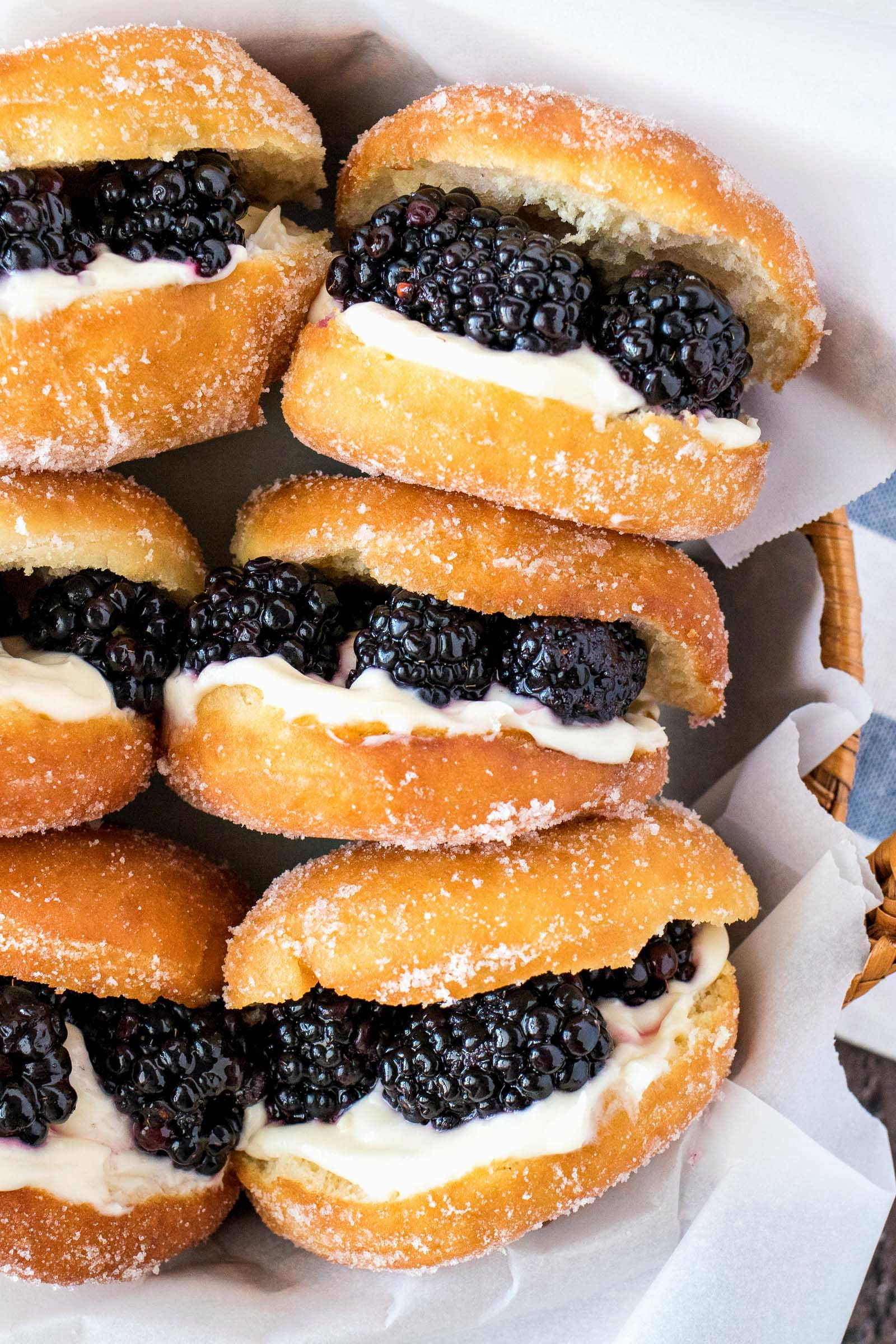 Blackberries & Cream Slider Doughnuts - Super fluffy yeast doughnuts that are tossed in sugar and then stuffed with a layer of cream cheese filling and topped with juicy blackberries. The perfect treat for any breakfast or brunch!