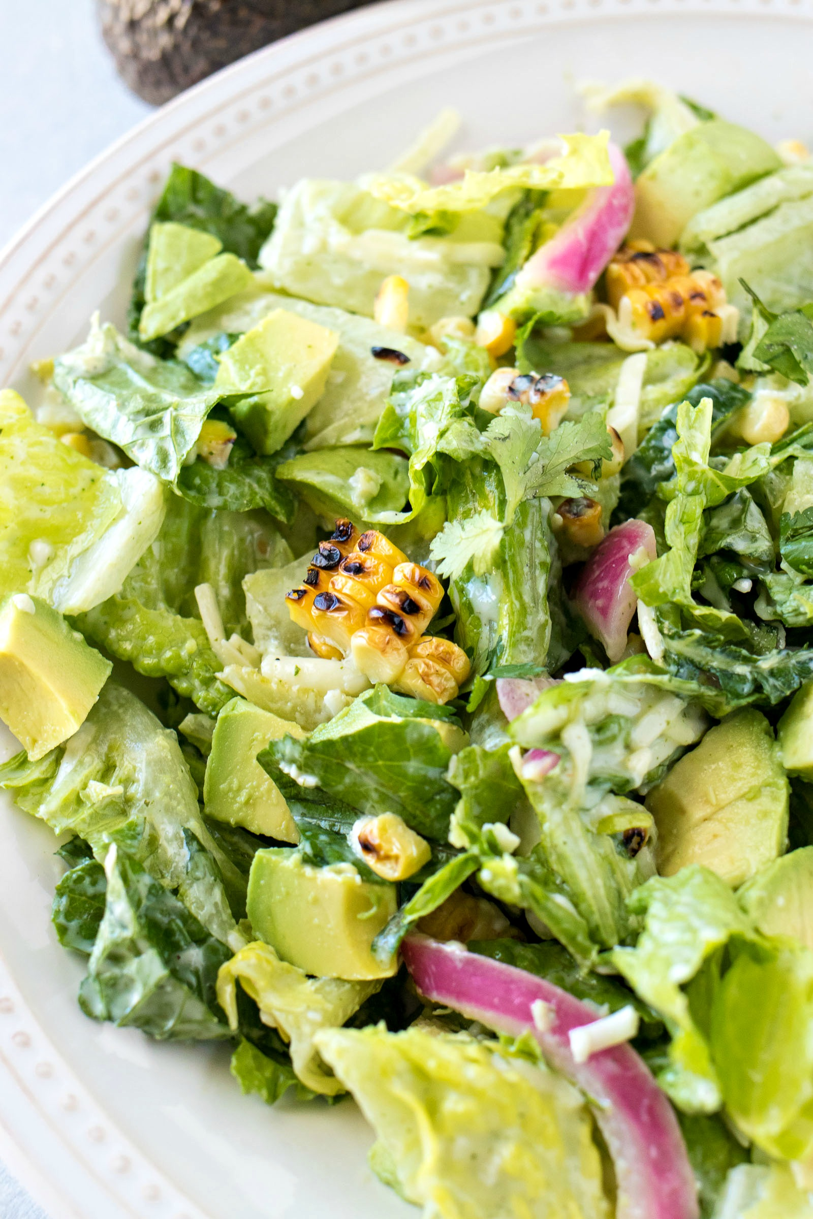 Closeup of Avocado and Charred Corn Salad with Cilantro Ranch Dressing