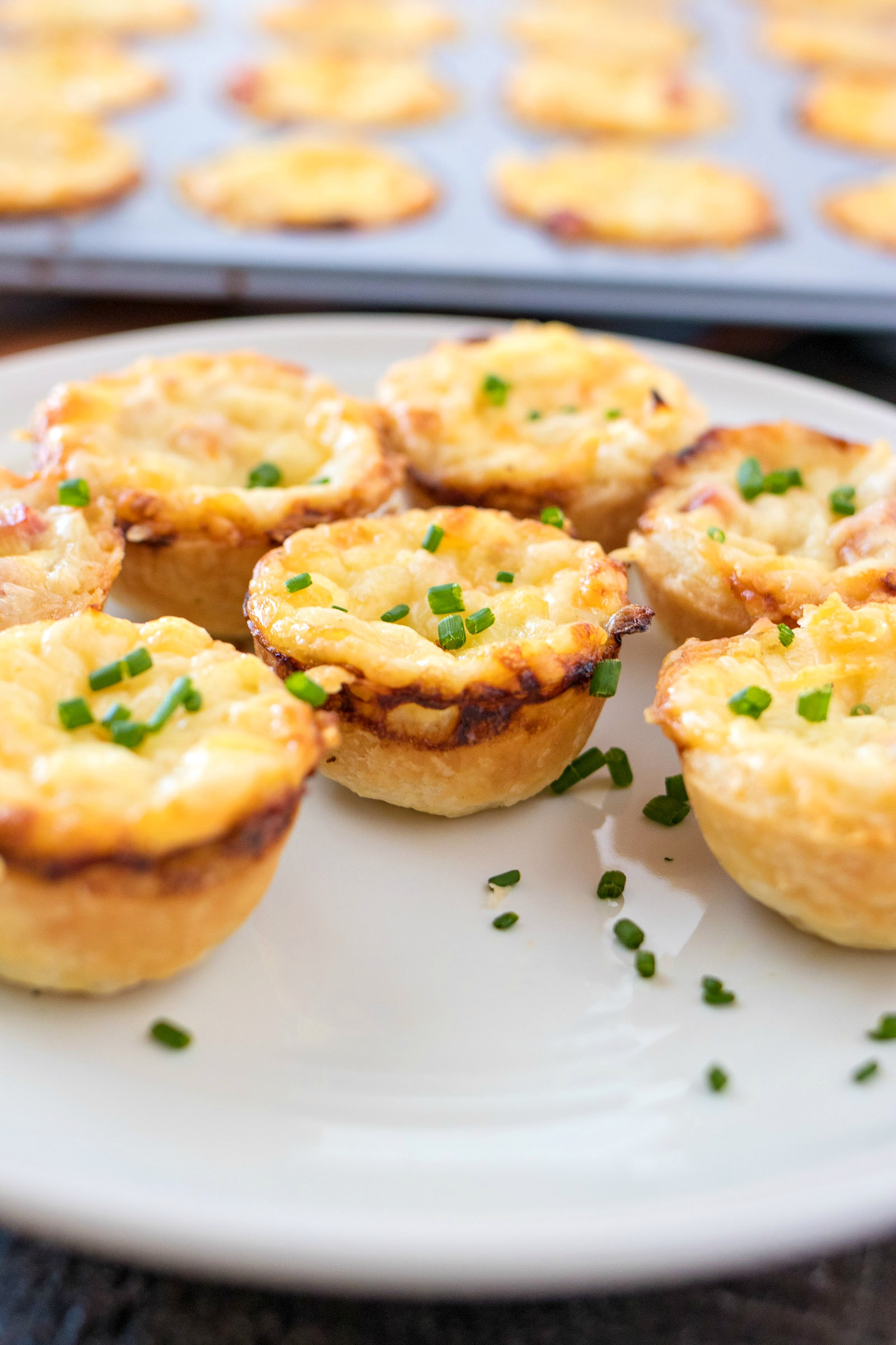 Mini Ham and Cheese Quiche with Caramelized Onions - A mini, buttery pastry crust filled with a mixture of eggs, cream, diced ham, gruyere cheese, and caramelized onions. These small little quiche are perfect for serving at parties and brunches.