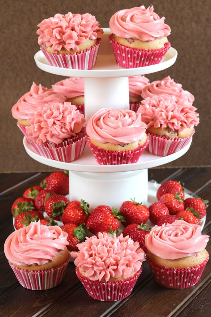 Display stand of strawberry cupcakes with buttercream frosting