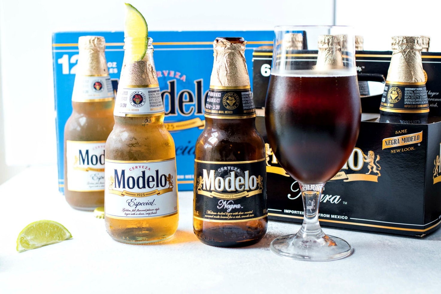 Two sic packs of Modelo, one especial, and one negro