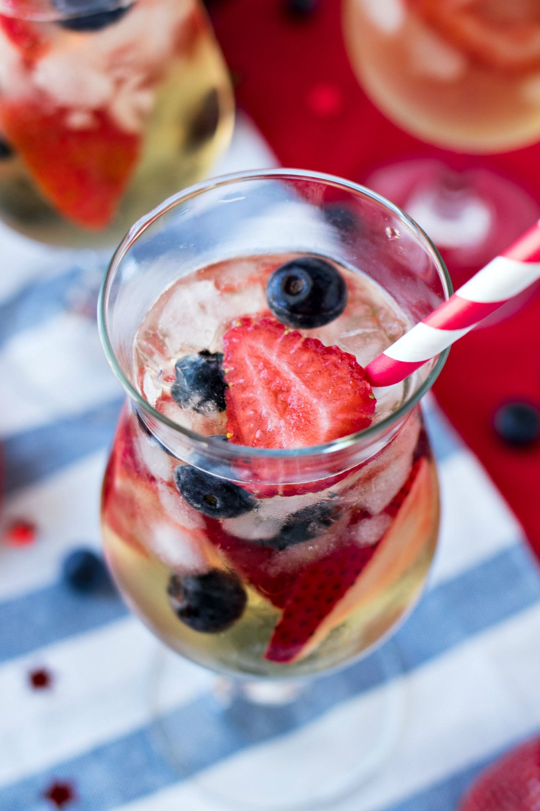 Red, White, & Blue Sangria - A refreshing white sangria made with dry white wine, brandy, and tons of strawberries and blueberries. It's the best Patriotic drink to serve for Memorial Day, 4th of July, and all summer long!