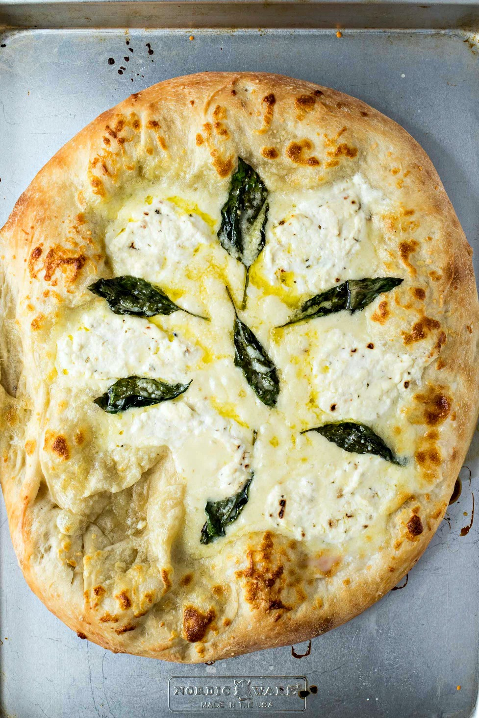 The Best Pizza Bianca (White Pizza) - The BEST white pizza you will ever make! Made with store-bought dough, shredded mozzarella cheese, ricotta cheese, and Pecorino Romano cheese, this pizza is super simple to make and will be best addition to your weeknight dinners.