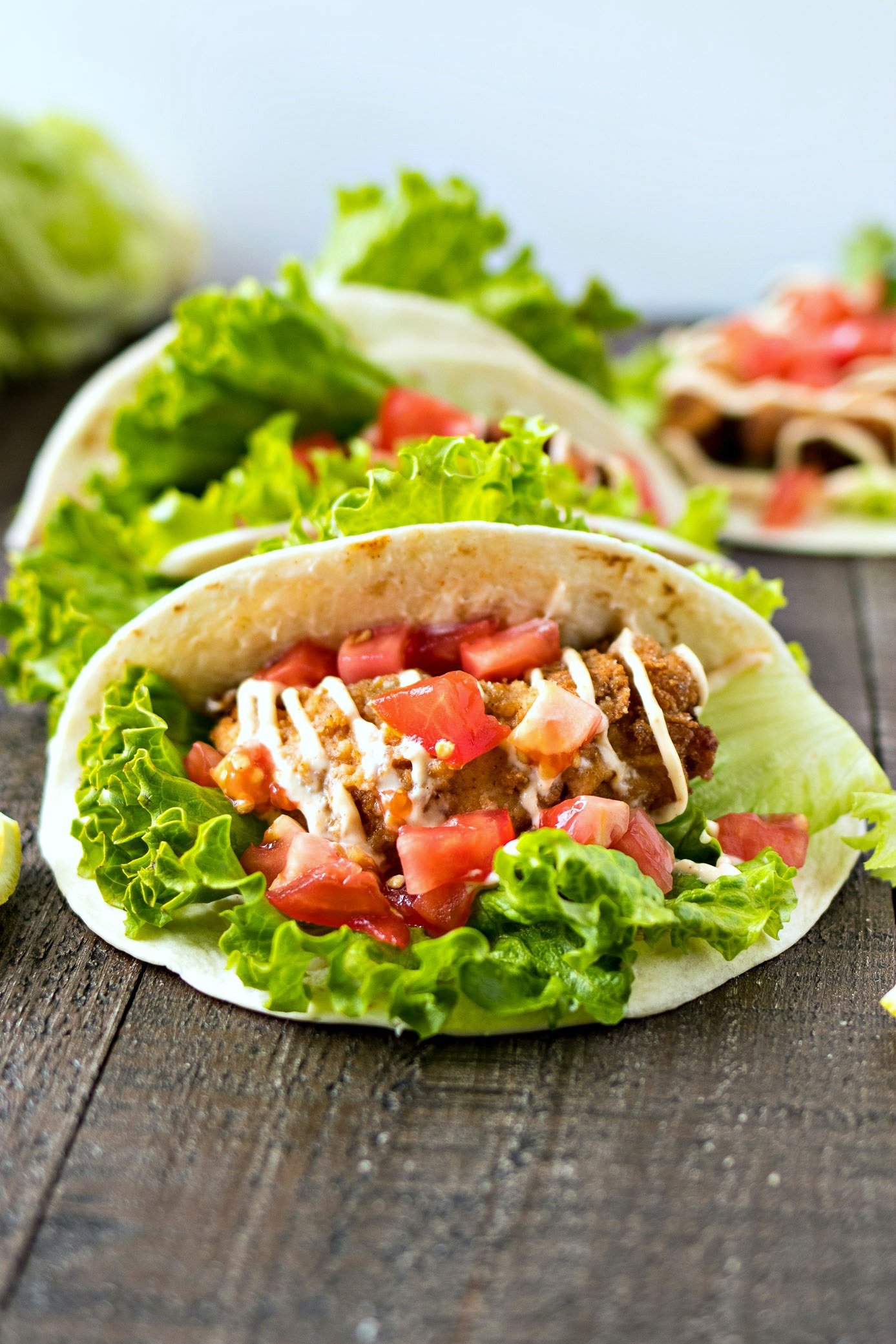 Fried Chicken Tacos filled with chicken, lettuce and tomatoes