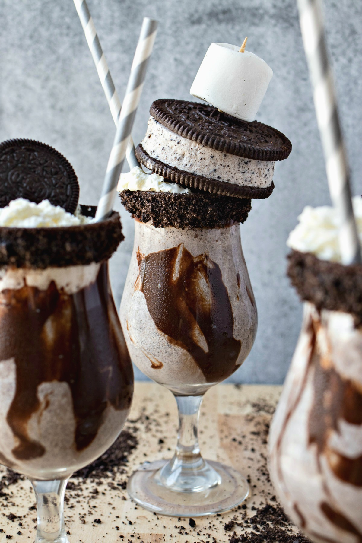 The Ultimate Cookies & Cream Milkshake with a cookie and marshmallow spear