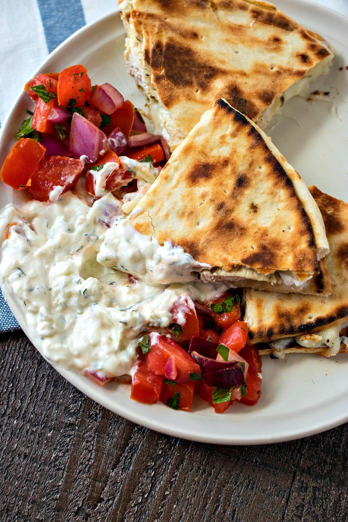 greek chicken quesadilla dipped in tzatziki sauce