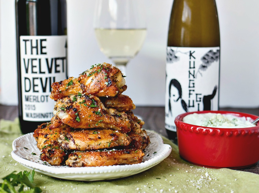 Italian Herb Wings with Gorgonzola Dipping Sauce - A flavorful recipe for wings that are baked, not fried! These wings are tossed in garlic, Parmesan cheese, and a trio of Italian herbs and then baked into incredibly crispy wings. They are then served with a homemade Gorgonzola dipping sauce and paired with a refreshing glass of Kung Fu Girl Riesling.